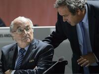 FILES - A picture taken on May 29, 2015 shows FIFA President Sepp Blatter (L) listening to UEFA President Michel Platini during the 65th FIFA Congress in Zurich. Embattled FIFA chief Joseph Blatter is suspected of