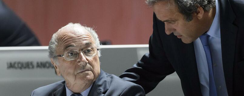 "FILES - A picture taken on May 29, 2015 shows FIFA President Sepp Blatter (L) listening to UEFA President Michel Platini during the 65th FIFA Congress in Zurich. Embattled FIFA chief Joseph Blatter is suspected of ""disloyal payment"" to UEFA head Michel Platini, who had hoped to succeed him, the office of Switzerland's attorney general said on September 25, 2015. AFP PHOTO / FABRICE COFFRINI"
