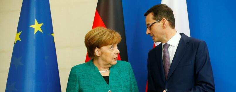 Chancellor Angela Merkel and Polish Prime Minister Mateusz Morawiecki address a news conference in Berlin, Germany, February 16, 2018. REUTERS/Hannibal Hanschke