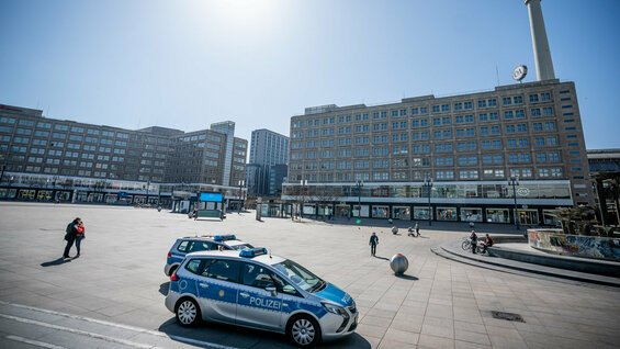 Deserted city squares, police patrolling the streets: The new normal in Germany's capital.