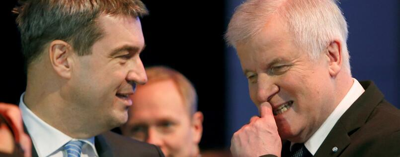 FILE PHOTO: Bavarian Prime Minister and head of the Christian Social Union (CSU) Horst Seehofer listens to Bavarian Finance Minister Markus Soeder (L) during a CSU party congress in Munich, Germany November 20, 2015. REUTERS/Michaela Rehle/File Photo