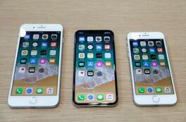FILE PHOTO: (L-R) iPhone 8 Plus, iPhone X and iPhone 8 models are displayed during an Apple launch event in Cupertino, California, U.S., September 12, 2017. REUTERS/Stephen Lam/File Photo