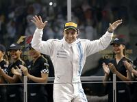 (FILES) This file photo taken on November 23, 2014 shows Williams' Brazilian driver Felipe Massa celebrating on the podium of the Yas Marina circuit in Abu Dhabi on November 23, 2014 after the Abu Dhabi Formula One Grand Prix. Massa is to retire definitively from Formula One at the end of the season he announced on November 4, 2017. The 36-year-old Williams pilot, who won 11 Grand Prix to date, decided to call it a day as his team are yet to confirm their line-up for next season. / AFP PHOTO / Karim SAHIB