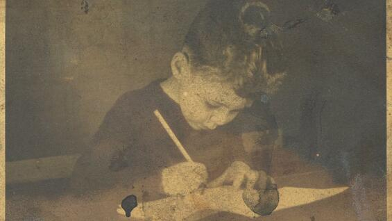 The great British painter Frank Auerbach as a child, drawing in his hometown Berlin., around 1935