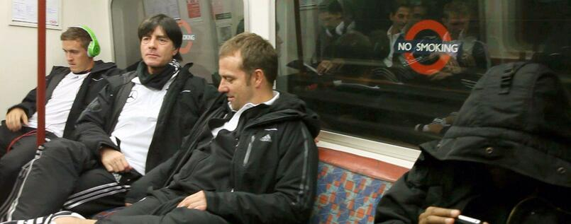 Joachim Löw (centre) enjoys the Bakerloo Line with Assistant Coach Hansi Flick (right) and striker Max Kruse (left).