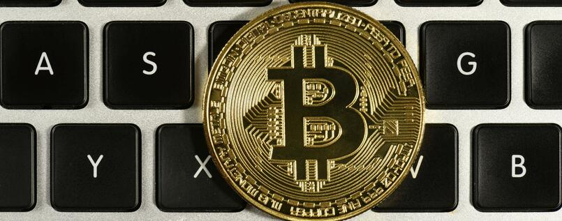 Bitcoins are a digital currency - the gold coin has become a symbol for them.