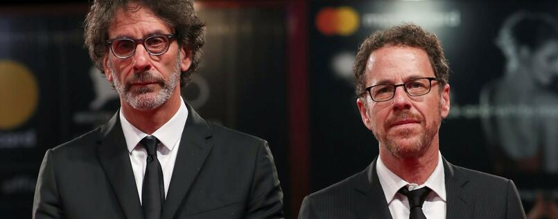 "The 75th Venice International Film Festival - ?Screening of the film ""The Ballad of Buster Scruggs"" competing in the Venezia 75 section - Red Carpet Arrivals - Venice, Italy, August 31, 2018 - Directors Ethan Coen and Joel Coen pose. REUTERS/Tony Gentile"