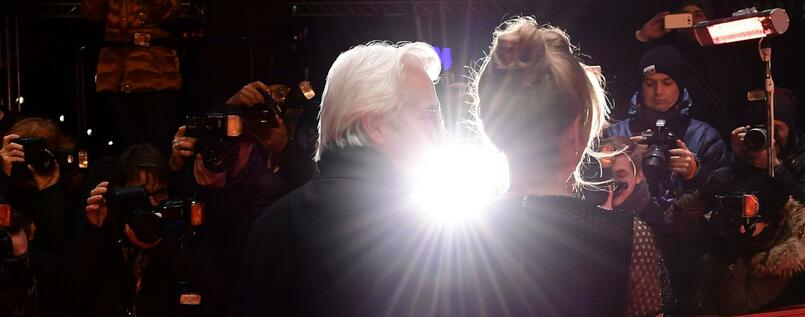"US actor Richard Gere and Alejandra Silva pose as they arrive on the red carpet for the premiere of the film ""The Dinner"" in competition during the 67th Berlinale film festival in Berlin on February 10, 2017. / AFP PHOTO / Tobias SCHWARZ"